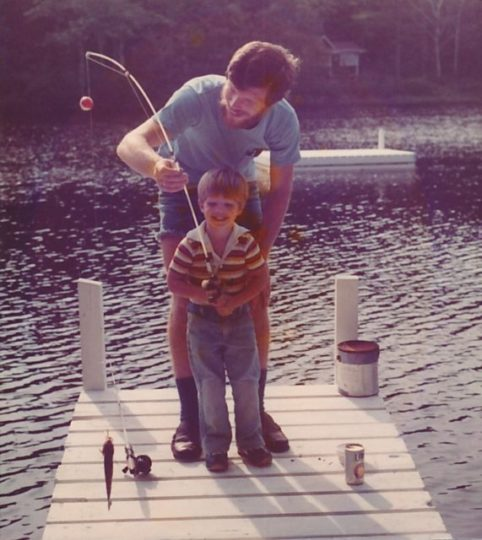 My dad, Jim Carr taking the time to show his son how to find some fish
